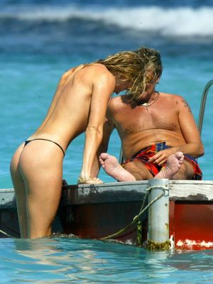 Penny Lancaster Topless photo 17