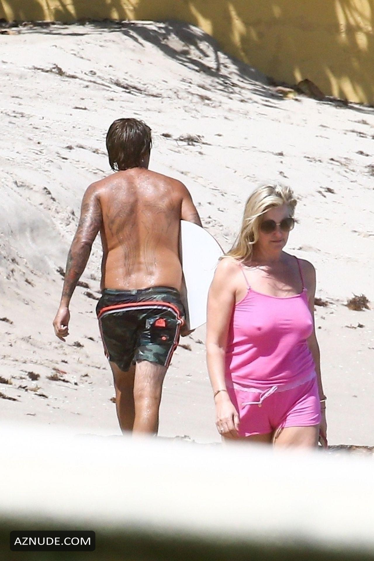 Penny Lancaster Topless photo 28